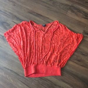 Orange floral top with smocking